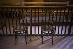 Two empty bentwood chairs royalty free stock images