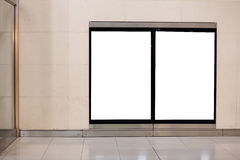 Two empty billboards. Two empty white blank billboards on the wall in metro Royalty Free Stock Images
