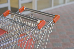 Two empty carts in a market Royalty Free Stock Photos