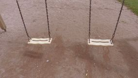 Two empty chain swings. In summer day stock video footage