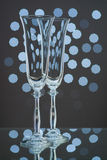 Two empty champagne glasses on blue background Stock Photos