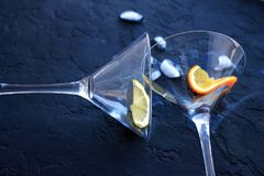 two empty cocktail glasses will fall overturned royalty free stock photo