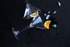 Two empty cocktail glasses will fall overturned stock image