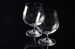Two empty cognac glasses. Isolated on black background Royalty Free Stock Images