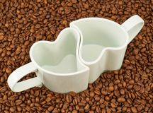Two empty cups on coffee beans Stock Photos