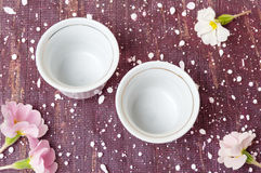 Two empty cups with flowers top view Stock Photography