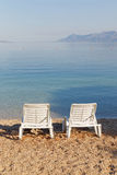 Two empty deck chair on the beach Royalty Free Stock Photos