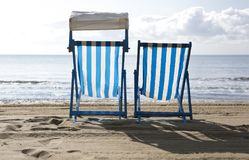 Two empty deck chairs Stock Photos