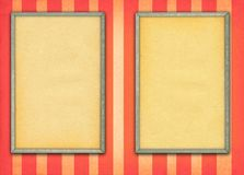 Two empty frames. On retro background with stripes Stock Images