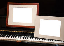 Two empty frames on piano Royalty Free Stock Photography