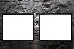 Two empty frames on brick wall. In museum Royalty Free Stock Images