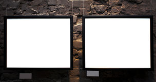 Two empty frames on brick wall. In museum Stock Photo