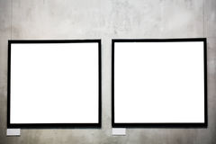 Two empty frames on cement wall. In museum Royalty Free Stock Photo
