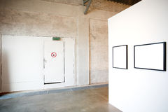 Two empty frames on white wall. In museum Royalty Free Stock Images