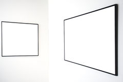 Two empty frames on white wall. In museum Royalty Free Stock Photos
