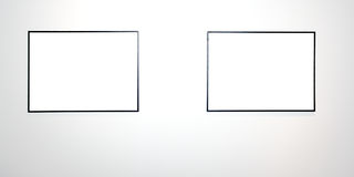 Two empty frames on white wall. In museum Stock Photo