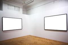 Two empty frames on white wall. In museum Stock Image