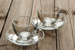 Two empty glass teacups on wooden background Stock Photos