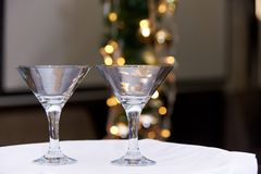Two empty glasses on a blurred background with bokeh royalty free stock images