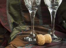 Two empty glasses of champagne and the cork close-up.  Stock Photo