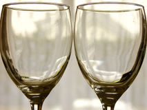 Two empty Glasses. Closeup of two empty Glasses in front of Window Royalty Free Stock Photography
