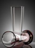 Two empty glasses on dark grey background Stock Photo