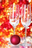 Two empty glasses and red ball decoration Stock Image
