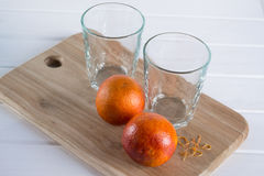 Two empty glasses and Sicilian oranges Royalty Free Stock Image