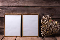 Two empty  golden frame and decorative heart with fairy light  o Royalty Free Stock Images