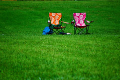 Two empty lawn chairs Royalty Free Stock Images