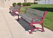 Two empty outdoor benches Stock Photos