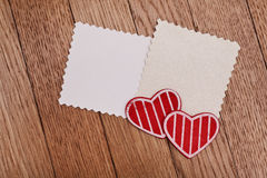 Two empty papers with red hearts Stock Photos
