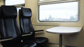 Two empty seats with table in the moving train Royalty Free Stock Photo