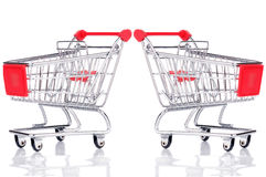 Two empty shopping carts Stock Photos