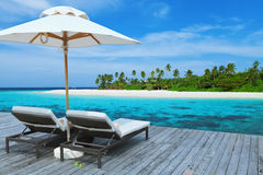 Two empty sunbed on the water villa, Maldives Island. Two empty sunbed on the water villa, beautiful seascape, relax, Maldives Island, Indian ocean royalty free stock photos