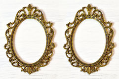 Two empty vintage picture frames. On white grunge background royalty free stock photos