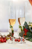 Two empty wedding champagne glasses on a table Stock Photo