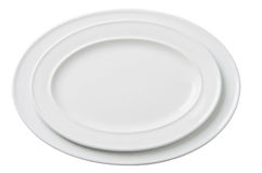 Two empty white oval plate isolated Stock Image