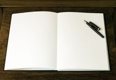 Two empty white pages and pen Stock Photography