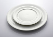 Two Empty white plates royalty free stock image