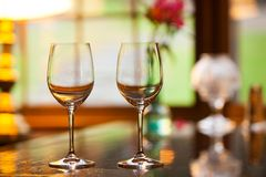 Two empty wine glasses on a bar. Royalty Free Stock Photos