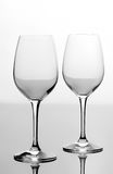 Two empty wine glasses. On white background stock images