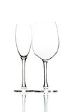 Two empty wine glasses on white. Close up Royalty Free Stock Photography