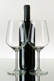 Two Empty Wineglasses and a Bottle of Red Wine. On Mirror Royalty Free Stock Photography