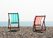Two empty wood frame deckchairs Stock Photography