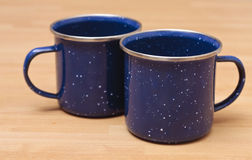 Two enamel mugs Stock Photos