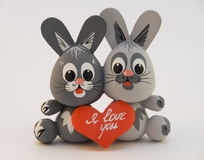 Two enamored rabbit. Wooden toy two lovers are kept hare heart symbol couples Stock Image