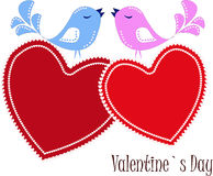 Two enamoured birdies on red hearts Stock Image