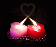 Two enamoured candles Royalty Free Stock Image