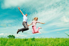 Two enamoured jump Stock Images